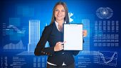 Businesswoman holding paper holde. Wire-frame buildings and graphs