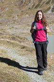 Woman Hiking In Autumn On Swiss Alps