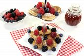 Poffertjes With Berries On A Cake Stand