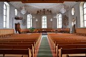 The interior of a Church viewed from the back, switzerland