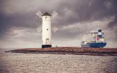 Retro Style Picture Of Ship Leaving Port, Swinoujscie In Poland.