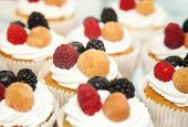 Cupcakes With White Cream And Berries