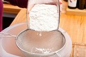 Put Flour Of Glass Bowl Through A Flour Sieve
