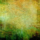 Textured old pattern as background. With different color patterns: yellow, green, brown, gray