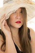 Woman Hat Red Lipstick Black Top Look Serious