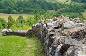 foto of old stone fence  - Stone fence near the old church ruins