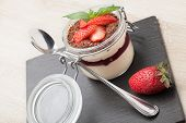 Delicious Italian Cream Dessert Pannacotta With Grated Chocolate, Strawberry, Basil