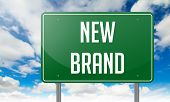 New Brand on Highway Signpost.