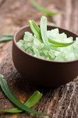 Green bath salt in little brown bowl