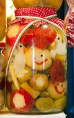 picture of pickled vegetables  - Funny jars of pickled vegetables on town market Budapes Hungary - JPG