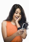 picture of unbelievable  - Shocked young woman reading text message - JPG