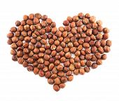pic of hazelnut  - Heart shape composition made of hazelnuts isolated over white background - JPG