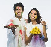 pic of holi  - Couple celebrating Holi - JPG