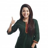 picture of salwar  - Portrait of a woman showing thumbs up sign and smiling - JPG