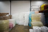 foto of packages  - Close up of plastic packaging and paper roll in a large warehouse - JPG