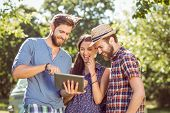 picture of friendship day  - Hipster friends looking at their selfie on a summers day - JPG