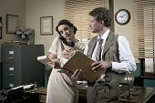 picture of 1950s style  - Young secretary on the phone and director working together 1950s vintage style office - JPG