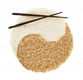 picture of yin  - Yin yang sign made of white and brown rice with the eating sticks over it forming a smiley face - JPG