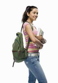stock photo of x-files  - Female college student holding files - JPG