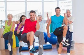 picture of senior class  - Portrait of fit people performing aerobics exercise in gym class - JPG