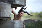 picture of hells angels  - The beautiful young girl with horns like devil or angel outdoor - JPG