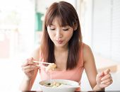 picture of chinese restaurant  - Asian girl eating dumpling noodles at Chinese restaurant - JPG
