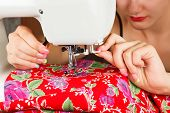 pic of sewing  - Seamstress sew fabric on the sewing machine - JPG