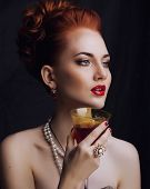 stock photo of ombres  - beauty stylish redhead woman with hairstyle and manicure wearing jewelry pearl - JPG