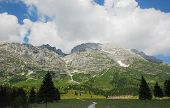 foto of farm land  - The rural mountainous landscape of the Altiplano de Montasio in the Friulian Alps in north east Italy - JPG