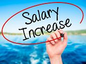 foto of employee month  - Man Hand writing Salary Increase with black marker on visual screen - JPG
