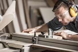 pic of joinery  - Young attractive man doing woodwork in carpentry - JPG