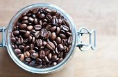 Rich Dark Coffee Beans In A Glass Recipient