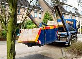 Truck Delivers Waste Container