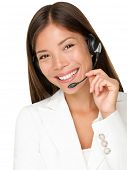 Headset. Customer service operator woman with headset smiling looking at camera. Beautiful mixed rac