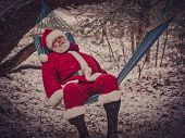 Santa Claus Rested In The Hammock In The Winter Forest. Christmas Vacation. Comfort , Overwork, Calm poster
