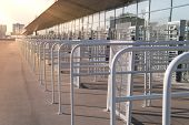 Security Entrance Gate - Secured Turnstiles Before Inspection At Stadium poster