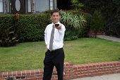 a business man uses a universal remote controll outside to controll TV, the Weather, people under hypnosis, and YOU!