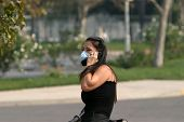 People wear paper masks, and bandannas to try to filter out the noxious curling black smoke from the