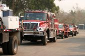 fire trucks line up for gas and diesel fuel and prepair to go battle the wild fires from the santiag