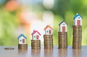 Mini House On Stack Of Coins, Real Estate Investment, Save Money With Stack Coin, Business Growth In poster