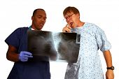 pic of anti-cancer  - A doctor and patient discuss a mans continuing to smoke cigarettes even with evidence of lung cancer Anti - JPG