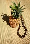 picture of kukui nut  - a fresh pineapple with a  - JPG