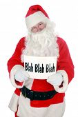 Santa holds a sign that reads