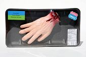 My original artwork,  plastic dismembered hand in a butchers wrap for a halloween prop