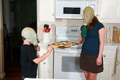 mother and son enjoy hot fresh baked cookies in their kitchen while wearing gas masks in the Future