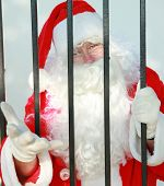 pic of 24th  - Santa Claus is behind bars in jail and needs your help to either be bailed out or escape before december 24th or there will no No Christmas for anyone this year - JPG
