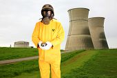 a police man or security guard in a yellow rain suit or anti Radiation Suit is worried about the rea