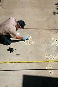 picture of blood drive  - a Crime Scene Investigator gathers evidence at the scene of a crime - JPG