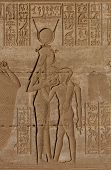 Goddess Hathor feeding Horus, a relief from the Ptolemaic period in Dendara, Egypt