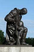 Huge statue of a kneeling soldier at the Soviet War Memorial in Treptower Park in Berlin, Germany